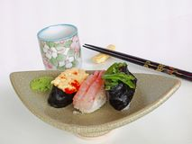 Japanese Sushi and Tea (Ocha). Ocha & Sushi served on a beautiful boat-shape plate Royalty Free Stock Photo