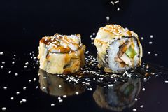Sushi with toppings. Japanese sushi with toppings on an isolated background Royalty Free Stock Photo