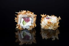 Sushi with toppings. Japanese sushi with toppings on an isolated background Royalty Free Stock Photography
