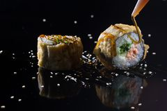 Sushi with toppings. Japanese sushi with toppings on an isolated background Stock Photo