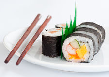 Japanese sushi traditional food with chopsticks. Japanese sushi traditional food on plate with chopsticks stock photography