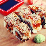 Japanese Sushi. Traditional Japanese Sushi rolls with avocado,eel , caviar and rice, instagram effect, square toned image Royalty Free Stock Photos