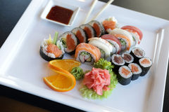 Japanese Sushi. Traditional Japanese sushi on a white plate with vegetables and japanese sauce Royalty Free Stock Photo