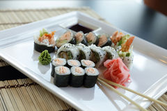 Japanese Sushi. Traditional Japanese sushi on a white plate with vegetables and japanese sauce Royalty Free Stock Image