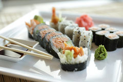 Japanese Sushi. Traditional Japanese sushi on a white plate with vegetables and japanese sauce Stock Photos