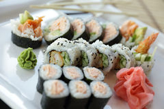 Japanese Sushi. Traditional Japanese sushi on a white plate with vegetables and japanese sauce Stock Photography