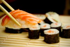 Japanese sushi. Tuna, sticks on bamboo napkin Stock Photography