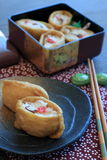 Japanese sushi wrapped in fried bean curd. Inari sushi, Japanese sushi wrapped in fried bean curd Stock Photos