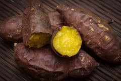 Japanese sweet potato. Burned Japanese sweet potato on bamboo mat, with vignette Stock Images