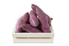 Japanese sweet potato in wooden crate pallet isolated on white b Royalty Free Stock Images