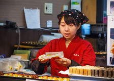 Japanese sweet shopkeeper in Kyoto Royalty Free Stock Photo