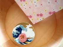 Japanese sweet, wooden container and floral patterns stock photography