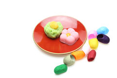 Japanese sweets on a plate with cocoon Stock Photos