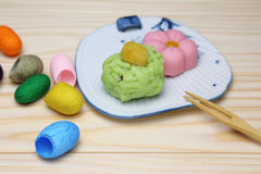 Japanese sweets on a plate with cocoon Stock Photography