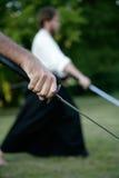 Japanese sword. Man's hand holding japanese sword Stock Photo