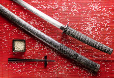 Japanese sword on a bamboo Mat Stock Image