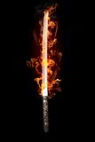 Japanese sword in flames. On a black background Stock Photos