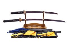 Japanese sword on wooden stand and silk bag in the front isolated stock photography