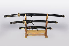 Japanese swords2. Three Japanese sword in sheath on the  support Royalty Free Stock Photo