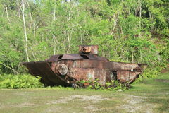 Japanese tank from WWII. Japanese tank from World War II in tropical forest on Peleliu island in Palau Stock Photos