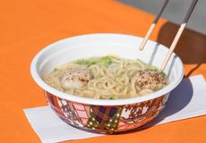 Japanese taste ramen soup with noodles,green onion,meat. Japanese taste ramen soup with noodles,green onion,meat, served in bowl and wooden sticks on the table royalty free stock photography