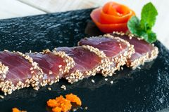 Japanese tataki served on black tile. Stock Photo