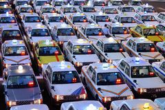 Japanese Taxis. Rows of Taxis October 29, 2012 in Sendai, JP. Japanese taxi fares are considered the highest in the world Royalty Free Stock Photos