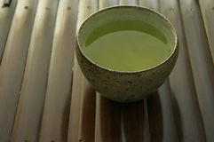 Japanese tea. Japanese green tea on wooden tea-tray Royalty Free Stock Photo