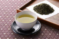 Japanese tea. Leaves and hot green tea royalty free stock photos