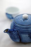 Japanese tea. A set of blue teapot and teacup in the background stock photo