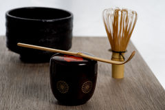Japanese tea ceremony setting on wooden bench. Royalty Free Stock Images