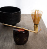 Japanese tea ceremony setting on wooden bench. Royalty Free Stock Photography
