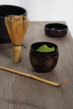 Japanese tea ceremony setting on wooden bench. Royalty Free Stock Photo