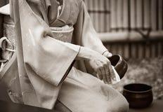 Japanese tea ceremony. Japanese woman prepares the tea ceremony show at tea house in public park, in Tsukuba, Japan stock photo