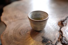 Japanese tea cup on wooden table. Japan royalty free stock photo