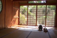 Japanese Tea House. An interior view of a Japanese Tea House looking out through the screen doors on a sunny day royalty free stock photography
