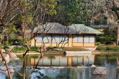 Japanese Tea House. A Japanese Tea House setting at the edge of a refection pond Royalty Free Stock Photos