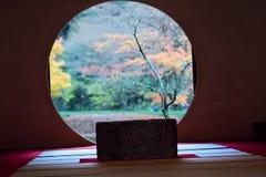 Japanese Tea house & Autumn through window Royalty Free Stock Images