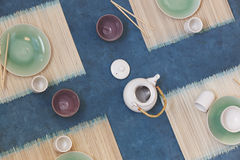 Japanese tea table with cups and dishes viewed from above Royalty Free Stock Photo