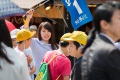 Japanese Teacher. JAPAN - JUNE 8, 2016: Japanese teacher elementary school taking students on field trip to Kiyomizu-dera Temple in summer at Kyoto, Japan Royalty Free Stock Image