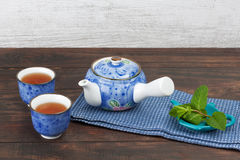 Japanese teapot with cups and mint Royalty Free Stock Photos
