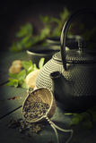 Japanese teapot and cups with mint tea Stock Photos