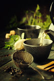 Japanese teapot and cups with mint tea Royalty Free Stock Photography