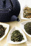 Japanese teapot and different sorts of green tea Stock Photography