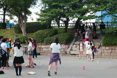 Japanese teenagers playing outdoor game activities Stock Photos