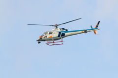 Japanese Television Helicopter. FUKUOKA, JAPAN - NOVEMBER 19, 2016: A Japanese television helicopter flies over the Louis Vuitton America`s Cup World Series Royalty Free Stock Image