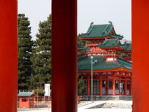 Japanese temple. A view of Heian Shrine,one of the most important Buddhist temple in Kyoto Japan,through its characteristic big orange gate Royalty Free Stock Photo