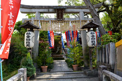 Japanese Temple Gate. Japanese stone temple gate, lanterns, and garden Royalty Free Stock Photos