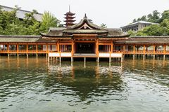 Japanese temple - Itsukushima shrine - Miyajima, Hiroshima, Japan. Japanese temple - Itsukushima shrine with reflection in the sea and five-story-temple Royalty Free Stock Photos
