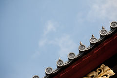 Japanese temple roof against blue sky. Royalty Free Stock Photography